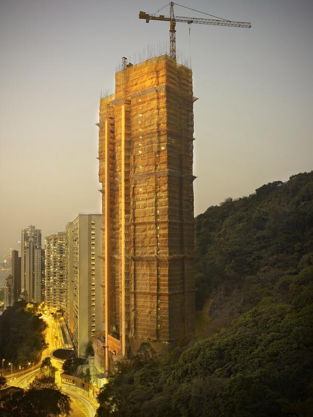 [Ảnh] Ấn tượng với cách người Hồng Kông xây dựng những tòa nhà chọc trời chỉ với giàn giáo bằng tre - Ảnh 9.