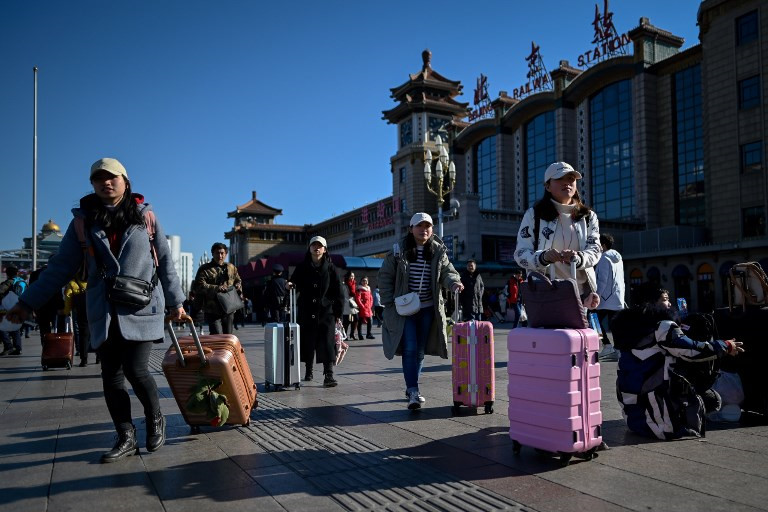Chùm ảnh: Hành trình về quê bằng tàu hỏa của người Trung Quốc trước Tết