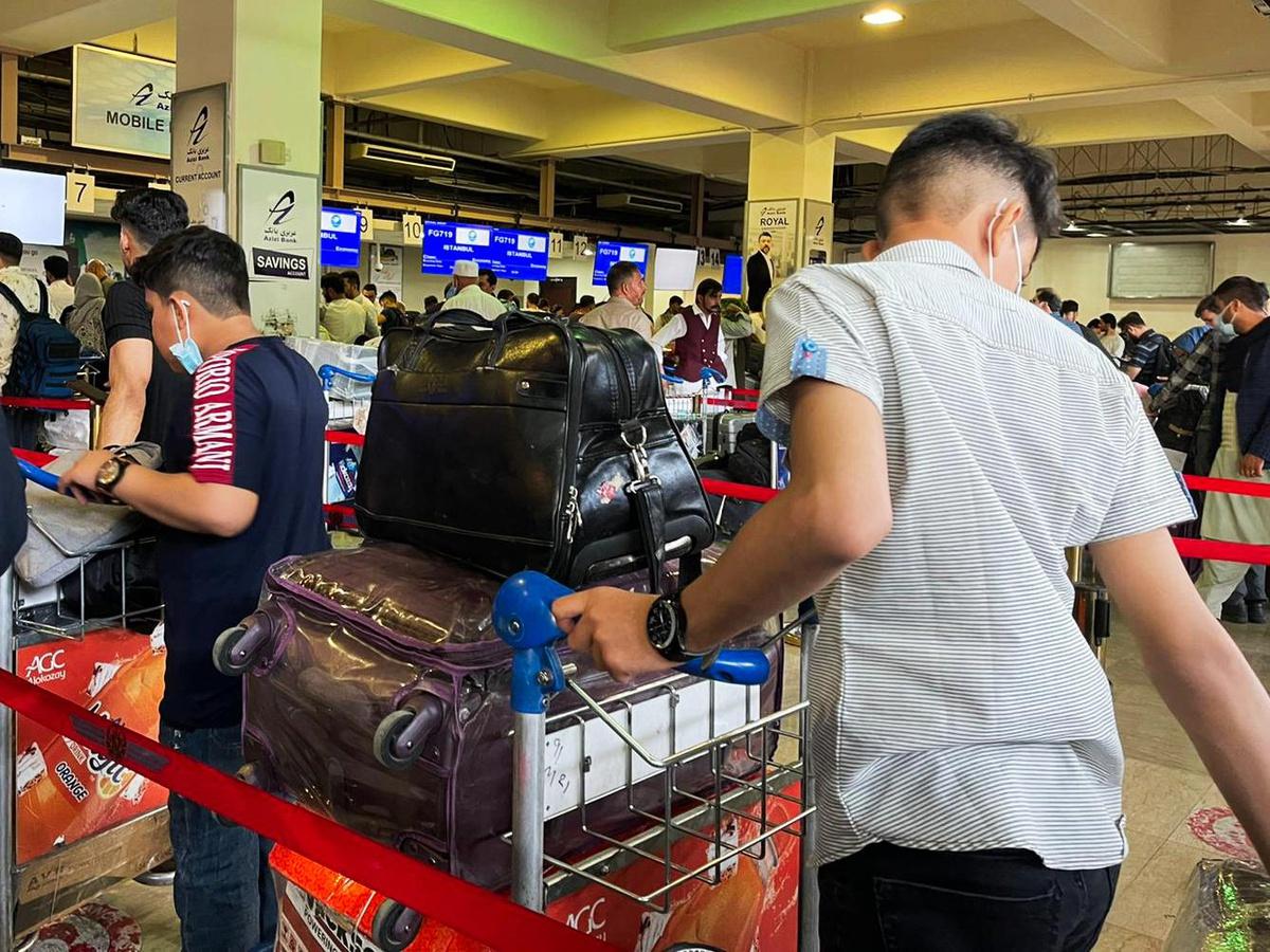 Chùm ảnh: Cuộc tháo chạy ở sân bay quốc tế Kabul